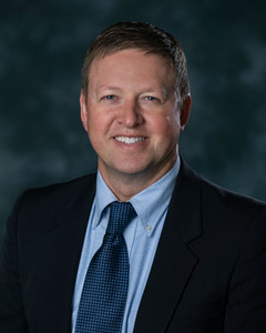 Headshot of Dr.Travis Bohrer, Dentist